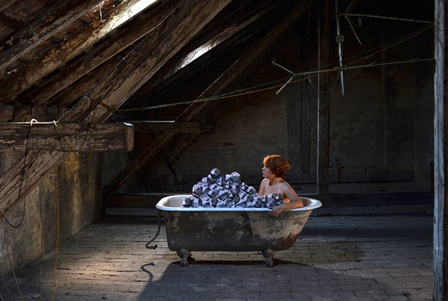Larissa Kopp, untitled – Performance in the attic of Sigmund Freuds former house, Berggasse 19, Vienna, c-print, 2014